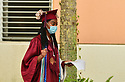 PEMBROKE PINES, FL - MAY 15: A student wears a protective mask during the graduation ceremony at Pembroke Pines Charter High School on May 15, 2020 in Pembroke Pines, Florida. Because of social distancing mandates instituted by the state to curtail the spread of COVID-19, the 2020 graduates received their diplomas in a near-empty auditorium with no friends, family or relatives allowed to attend. A video of each student walking the stage to receive their diploma will be streamed on the school's scheduled graduation date of May 29.  ( Photo by Johnny Louis / jlnphotography.com )