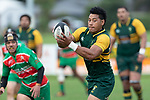 Sione Fifita throws a dummy pass as he tries to confuse the Waiuku defenders. Counties Manukau Premier Club rugby game between Pukekohe and Waiuku, played at Colin Lawrie Fields, Pukekohe on Saturday April 14th, 2018. Pukekohe won the game 35 - 19 after leading 9 - 7 at halftime.<br /> Pukekohe Mitre 10 Mega -Joshua Baverstock, Sione Fifita 3 tries, Cody White 3 conversions, Cody White 3 penalties.<br /> Waiuku Brian James Contracting - Lemeki Tulele, Nathan Millar, Tevta Halafihi tries,  Christian Walker 2 conversions.<br /> Photo by Richard Spranger