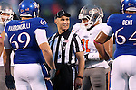 13 October 2012: Umpire Rick Prodaza talks with KU's Trevor Marrongelli (69) and Randall Dent (64). The Oklahoma State University Cowboys played the University of Kansas Jayhawks at Memorial Stadium in Lawrence, Kansas in a 2012 NCAA Division I Football game.