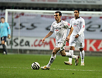 Pictured: Leon Britton of Swansea City in action<br />