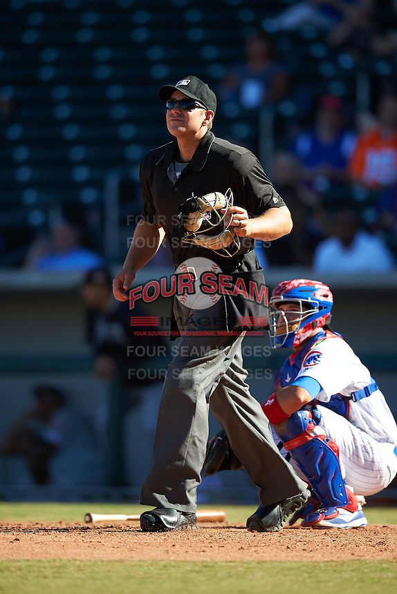 Umpire John Libka keeps his eye on the ball in front of catcher Victor Caratini during an Arizona Fall League game between the Scottsdale Scorpions and Mesa Solar Sox on October 18, 2016 at Sloan Park in Mesa, Arizona.  Mesa defeated Scottsdale 6-3.  (Mike Janes/Four Seam Images)