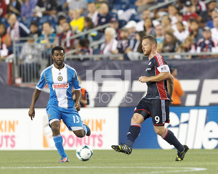 New England Revolution midfielder Chad Barrett (9) passes the ball. Philadelphia Union substitute midfielder Michael Lahoud (13). In a Major League Soccer (MLS) match, the New England Revolution (dark blue) defeated Philadelphia Union (light blue), 5-1, at Gillette Stadium on August 25, 2013.
