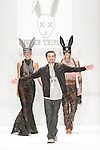 "Fashion designer Erik Rosete walks runway with models for the close of his Mister Triple X Fall Winter ""All X in Wonderland"" collection fashion show, for the Art Hearts Fashion Fall 2015 runway show, during Mercedes-Benz Fashion Week Fall 2015 in New York City."