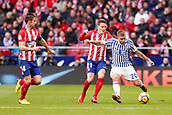 2nd December 2017, Wanda Metropolitano, Madrid, Spain; La Liga football, Atletico Madrid versus Real Sociedad; Kevin Rodrigues (20) of Real Sociedad gets his pass away under pressure from Grabiel Fenandez Arenas and Kevin Gameiro (21) of Atletico Madrid