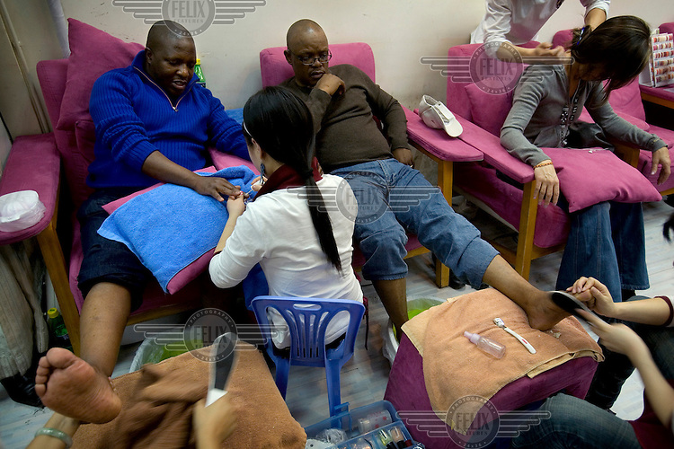 South African businessmen receive pedicures and manicures in Beijing..