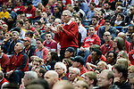 Wisconsin Badgers fan Andy North (standing) cheers during the third-round game in the NCAA college basketball tournament against the Oregon Ducks Saturday, April 22, 2014 in Milwaukee. The Badgers won 85-77. (Photo by David Stluka)