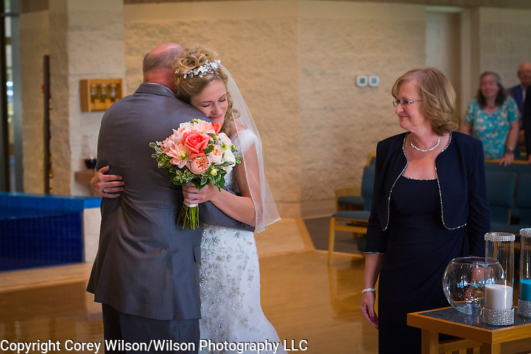 Megan Wene and Ryan Roth wedding at St. Joan of Arc Catholic church in Nashotah, Wis., and reception at the Golden Mast on Lake Okauchee on July 16, 2016.