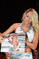 Miami Dolphins Cheerleader Lauren J signs calendar at Miami Dolphins Cheerleaders Swimsuit 2014 Calendar Unveiling and Fashion Show at Fontainebleau's LIV nightclub, Miami Beach, FL, September 5, 2013