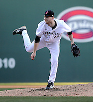 Pitcher Matthew Lathuras (39) of the Cincinnati Bearcats in a game against the Western Carolina Catamounts on Sunday, February 24, 2013, at Fluor Field in Greenville, South Carolina. Cincinnati won in 10 innings, 7-6. (Tom Priddy/Four Seam Images)