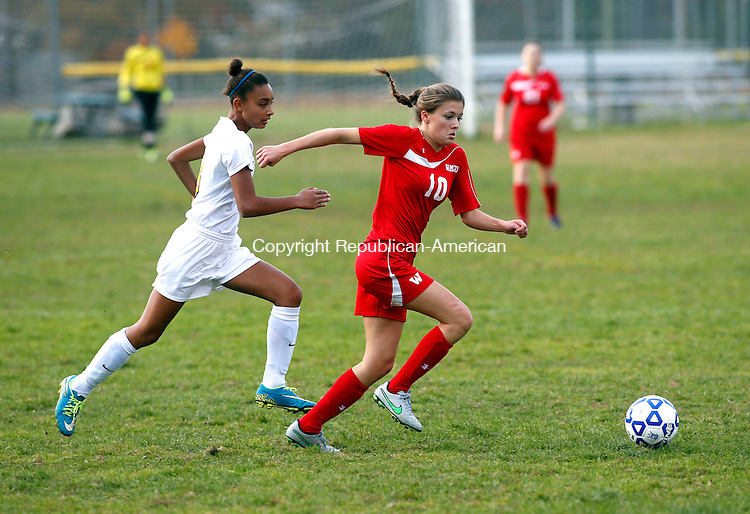 Winsted, CT- 27 October 2015-102715CM02- Wamogo's Brooke Neller, right, and Gilbert's Skyeshay Smith go after the ball during their soccer matchup in Winsted on Tuesday.     Christopher Massa Republican-American