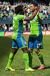 Seattle Sounders Obafemi Martins, left, is congratulated by Lamar Neagle after scoring a goal against the Colorado Rapids during an MLS match on April 26, 2014 in Seattle, Washington.  The Seattle Sounders beat the Colorado Rapids 4-1.  Jim Bryant Photo. ©2014. All Rights Reserved.