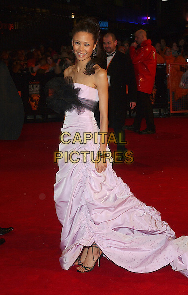 THANDIE NEWTON.The 2006 Orange British Academy Film Awards, Odeon Leicester Square, London, UK..February 19th, 2006.Ref: BEL.full length umbrella purple dress lilac black sash strapless gathered bafta baftas.www.capitalpictures.com.sales@capitalpictures.com.© Capital Pictures.
