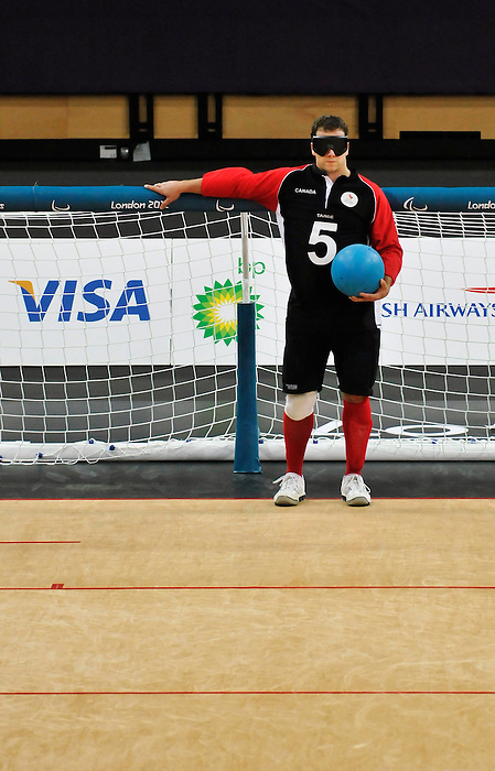 LONDON, ENGLAND 08/31/2012  Bruno Hache of the Men's Goalball team competes in the Preliminary Group B against Iran at the London 2012 Paralympic Games at the Copper Box.  (Photo by Daniel Marcotte/Canadian Paralympic Committee)