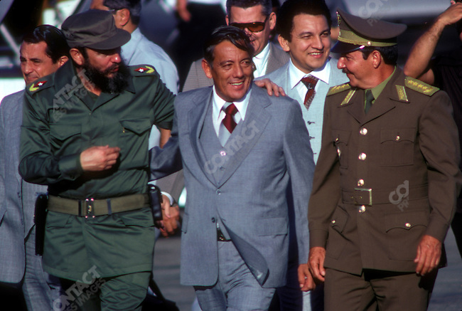 Fidel Castro, (left) President of Cuba, with Omar Torrijos (center) leader of Panama, and Raul Castro (right), Cuban Minister of Defense, at the Non-Aligned Movement Summit. Cuba, September 1979.<br />