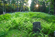 Gilman-Hall Cemetery along Sandwich Notch Road in Sandwich, New Hampshire USA. During the early nineteenth century thirty to forty families were part a hill farm community in the Notch. By 1860 only eight families lived in the Notch and by the turn of the twentieth century only one person, Moses Hall, lived in the Notch year around. Now a private residence the Hall Place is the only house left on the Notch Road.