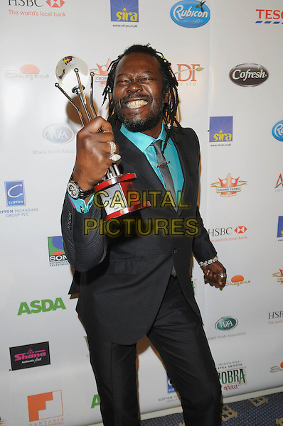 LEVI ROOTS .Attending the World Food Awards (WFA), Park Lane Hilton Hotel, London, England, UK, 31st October 2009..half length grey gray suit green shirt tie award winner trophy beard facial hair smiling eyes shut funny .CAP/FIN.©Steve Finn/Capital Pictures