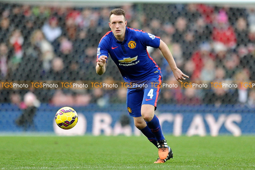 Phil Jones of Manchester United - Stoke City vs Manchester United - Barclays Premier League Football at the Britannia Stadium, Stoke-on-Trent - 01/01/15 - MANDATORY CREDIT: Greig Bertram/TGSPHOTO - Self billing applies where appropriate - contact@tgsphoto.co.uk - NO UNPAID USE