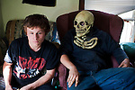 "Michael ""Roady"" Melnek plays video games at Cameron's house while J.R. Harrison watches with a halloween mask on. J.R.'s brother Dustin used to wear the mask uptown in New Straitsville before he took his own life in January 2011."