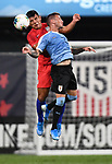 Nick Lima (left) of the United States and Brian Lozano of Uruguay leap for a header during an international friendly game on September 10, 2019 at Busch Stadium in St. Louis, Missouri USA<br /> AFP Photo by Tim VIZER