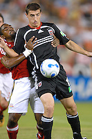 DC United forward Rod Dyachenko (15) shields the ball from New York Red Bulls defender Marvell Wynne (2).  DC United defeated the New York Red Bulls 4-3. DC United earned a top seed in the 2006 MLS Playoffs and will enjoy home field advantage for the entire Eastern Conference Playoffs. Saturday, September 23, 2006, at RFK Stadium.