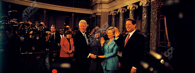 Hillary CLINTON swearing in as Senator from New York, by Al Gore. with her husband Bill and daughter Chelsea. Washington D.C. January 2001