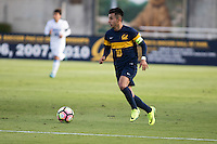 BERKELEY, CA - Oct. 13, 2016: Cal's (10) Jose Carrera-Garcia dribbles   against UCLA.  Cal Men's Soccer played UCLA on Goldman Field at Edwards Stadium.