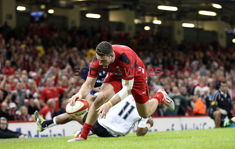Wales wing Alex Cuthbert goes over to score the second try of the match.<br /> Dove Men Series 2014<br /> Wales v Fiji<br /> Millennium Stadium<br /> 15.11.14<br /> ©Steve Pope-SPORTINGWALES