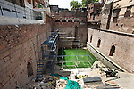 A view of the 700 year old Nizamuddin Baoli (which is a stepped well) that has people living on all sides and is in danger of collapse. The Archaeological Survey of India has been on a campaign to evict people who have illegally made heritage sites their homes throughout the city in recent times but is facing stiff opposition from the residents. The area is littered with tombs that need excavation.