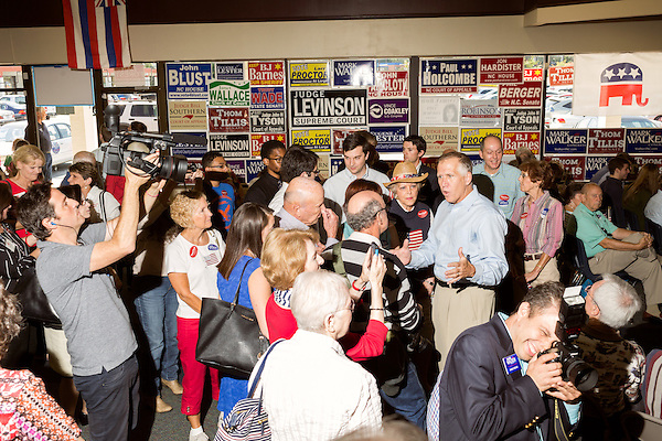 September 20, 2014. Greensboro, North Carolina.<br />  US Senate candidate Thom Tillis, right in oxford shirt, greeted and spoke to rally attendees as he arrived.<br />  Thom Tillis and Mark Walker hosted a rally at the Guilford County Republican Party headquarters for their supporters in the upcoming November election. Tillis, the current Speaker of the House for the NC House of Representatives, is running to take Democrat Kay Hagan's US Senate seat, while Walker, a local pastor, is running for the NC 6th District' s US Congressional seat.