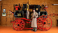 BNPS.co.uk (01202 558833)<br /> Pic: PhilYeomans/BNPS<br /> <br /> Restorer and carriage driver Mark Broadbent has spent two years completely rebuilding the historic vehicle.<br /> <br /> Last Post - Britain's last Royal Mail carriage, that bizarrely once survived an attack by a lion outside Salisbury, has been saved for the nation.<br /> <br /> The 200-year-old horse-drawn carriage harks back to the golden age of the Royal Mail when crowds gathered along the route to see the lightning-quick service thunder by.<br /> <br /> The restored four horse coach was known as 'Quicksilver' as it was the fastest in the land on its regular 21 hour run from Devonport, Devon, to London.<br /> <br /> But the red and black wooden wagon went down in history for an extraordinary incident involving a lion in the English countryside in 1816.