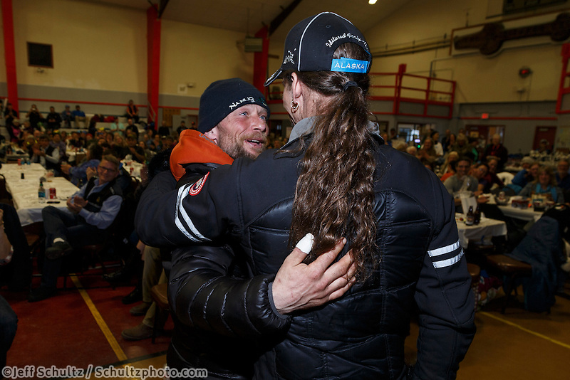 Brothers, Jason and Lance Mackey hug after they both recieved special sportsmanship awards at the finishers banquet in Nome on Sunday  March 22, 2015 during Iditarod 2015.  <br /> <br /> (C) Jeff Schultz/SchultzPhoto.com - ALL RIGHTS RESERVED<br />  DUPLICATION  PROHIBITED  WITHOUT  PERMISSION