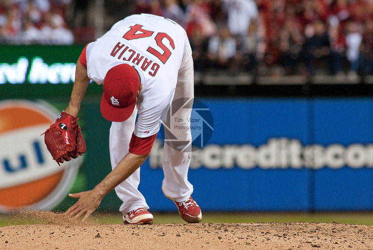 06 May 2011                              St. Louis Cardinals starting pitcher Jaime Garcia (54) brushes his fingertips in the pitchers mound soil before throwing.  He had a no-hitter going until the eighth inning, when the Brewers got two hits off him.  The St. Louis Cardinals defeated the Milwaukee Brewers 6-0 on Friday May 6, 2011 in the first game of a three-game series at Busch Stadium in downtown St. Louis.
