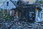 HDR image of a burnt down house and garage