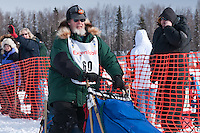 Musher # 60 Eric Rogers at the Restart of the 2009 Iditarod in Willow Alaska