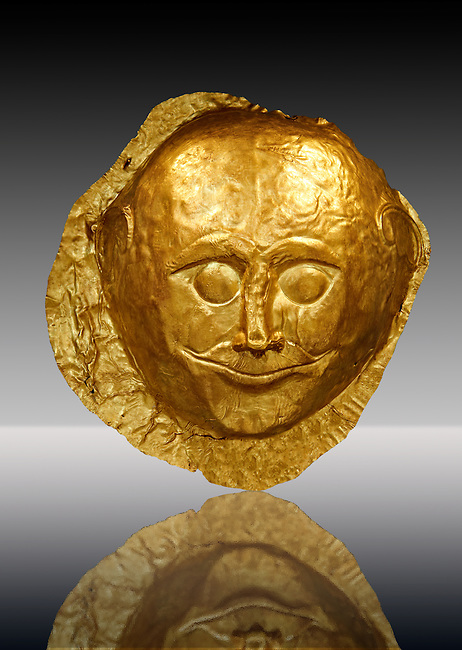 Gold Death Mask  from Grave V, Grave Circle A, Mycenae. The mask is made of a thin sheet of beaten gold and is the only mask from grave circle A with eyes open. 16th century BC. Cat No 259 Athens Archaeological Museum.
