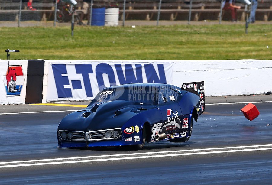 Jun. 1, 2014; Englishtown, NJ, USA; NHRA pro mod driver Clint Satterfield goes sideways on two wheels after crossing the center line and hitting a timing block during the Summernationals at Raceway Park. Mandatory Credit: Mark J. Rebilas-