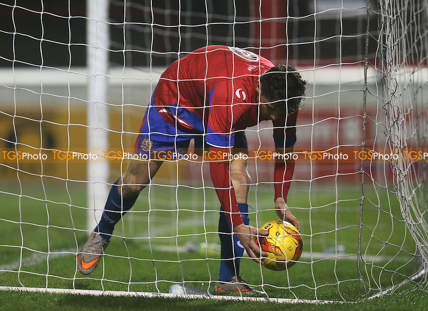 Matt McClure of Dagenham picks the ball out of the net after scoring a penalty during Dagenham and Redbridge vs Basildon United, BBC Essex Senior Cup Football at the Chigwell Construction Stadium, London, England on 03/11/2015