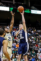 February 08, 2011:   North Florida Ospreys forward Matt Sauey (22) goes up for a shot while being defended by Jacksonville Dolphins forward Delwan Graham (21) during Atlantic Sun Conference action between the Jacksonville Dolphins and the North Florida Ospreys at Veterans Memorial Arena in Jacksonville, Florida.  Jacksonville defeated North Florida 71-69.