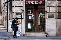 A woman wearing a mask to protect herself from the Covid-19 walks past a closed cafe in Rome, Italy, March 10, 2020. The Italian government imposed restriction aimed to contain the Covid-19 spread, including cafes, restaurants and other shops forced to close at 6pm and forbidding personal movement.<br /> UPDATE IMAGES PRESS/Riccardo De Luca