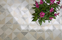 Christopher, a hand-cut mosaic shown in honed Bianco Antico, Carrara, and Calacatta Tia, is part of the Illusions® collection by Sara Baldwin for New Ravenna.