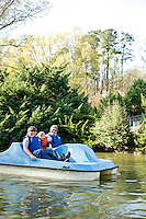 Stephen, Logan, and Stephanie Sparrow Paddle boating at Pullen Park.
