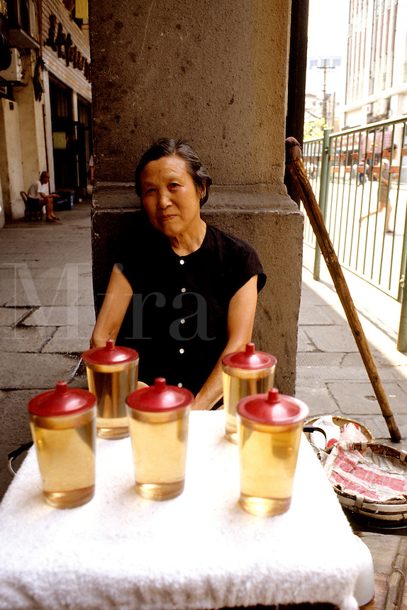 Colorful portrait of a woman selling tea on the streets of Shanghai China
