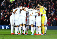 Swansea City team huddle during the Barclays Premier League match between Manchester United and Swansea City played at Old Trafford, Manchester on January 2nd 2016