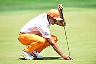 Bethesda, MD - July 1, 2018:  Rickie Fowler lines up a putt during the final round of professional play at the Quicken Loans National Tournament at TPC Potomac at Avenel Farm in Bethesda, MD.  (Photo by Phillip Peters/Media Images International)