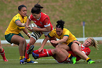 Amanda Thornborough (centre) takes an intercept off Fenella Hake (2nd right) during the 2017 International Women's Rugby Series rugby match between Canada and Australia Wallaroos at Smallbone Park in Rotorua, New Zealand on Saturday, 17 June 2017. Photo: Dave Lintott / lintottphoto.co.nz