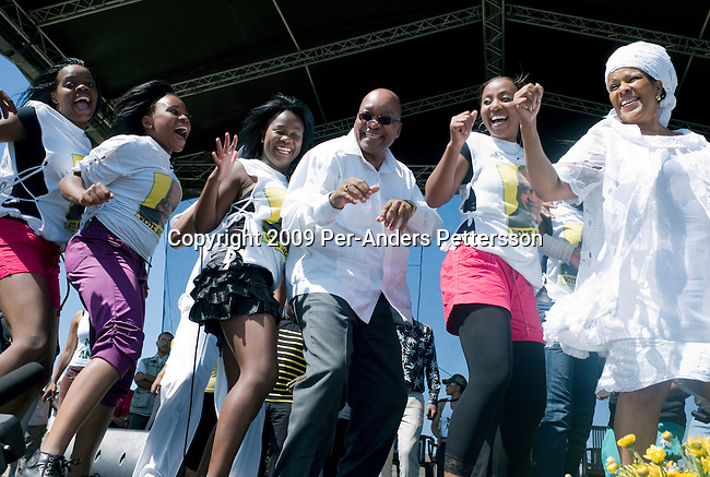 KHAYELITSHA, SOUTH AFRICA FEBRUARY 22: ANC president Jacob Zuma sings and dances with a dance group after a speech at a rally on February 22, 2009 in Khayelitsha a poor township outside Cape Town, South Africa. Mr. Zuma went for a door-to-door campaign to drum up support for his party ahead of the elections. Mr. Zuma was recently cleared of several fraud and corruption charges and he is expected to win the general election on April 22, and become South Africa?s third democratic elected president. (Photo by Per-Anders Pettersson/Getty Images)..