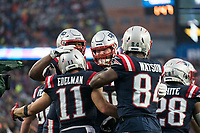 FOXBOROUGH, MA - OCTOBER 27: New England Patriots Wide Receiver Julian Edelman #11 celebrates with teammates New England Patriots Offensive lineman Marcus Cannon #61, New England Patriots Offensive lineman Joe Thuney #62, New England Patriots Tight end Benjamin Watson #84 after a touchdown during a game between Cleveland Browns and New Enlgand Patriots at Gillettes on October 27, 2019 in Foxborough, Massachusetts.