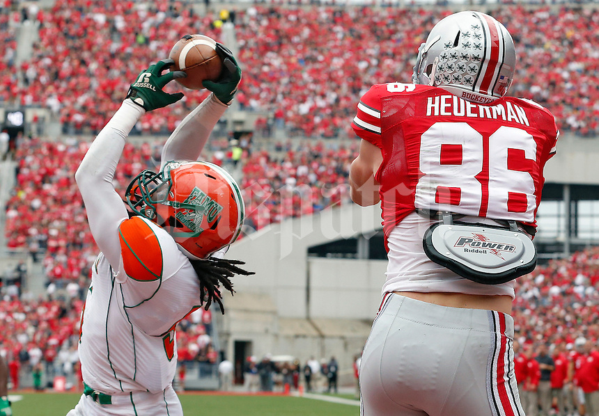 Florida A&M Rattlers defensive back Patrick Aiken (5) interceptions a pass attended to Ohio State Buckeyes tight end Jeff Heuerman (86) in the 1st quarter during their college football game at Ohio Stadium on September 21, 2013.  (Dispatch photo by Kyle Robertson)