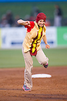 Kannapolis Intimidators Director of Promotions Amber Sersen runs the bases dressed as a hot dog between innings of the game against the Hickory Crawdads at CMC-Northeast Stadium on May 19, 2014 in Kannapolis, North Carolina.  The Crawdads defeated the Intimidators 10-6.  (Brian Westerholt/Four Seam Images)