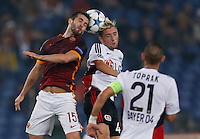 AS Roma's Miralem Pjanic fight for the ball with Leverkusen's Jonathan Tah  during the Champions League Group E soccer match between As Roma and  Bayer Leverkusen at the Olympic Stadium in Rome, November 04 2015